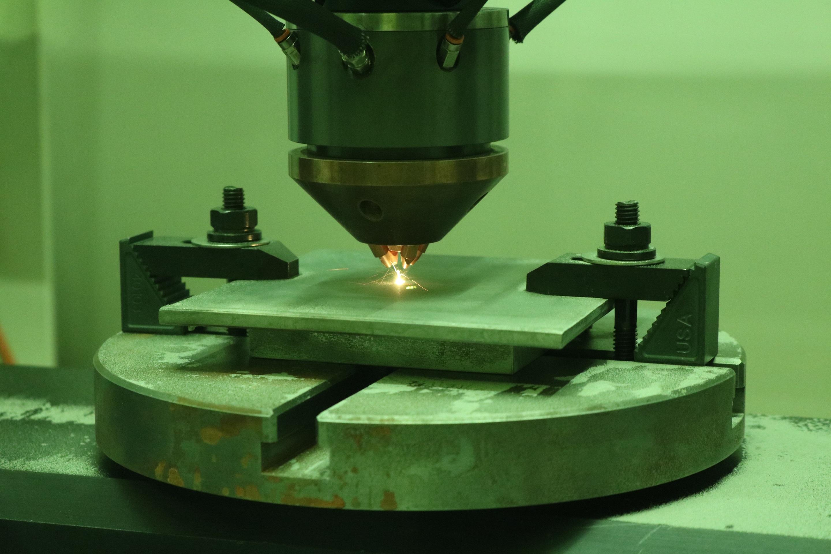 Engineers conduct bead on plate trials using additive manufacturing