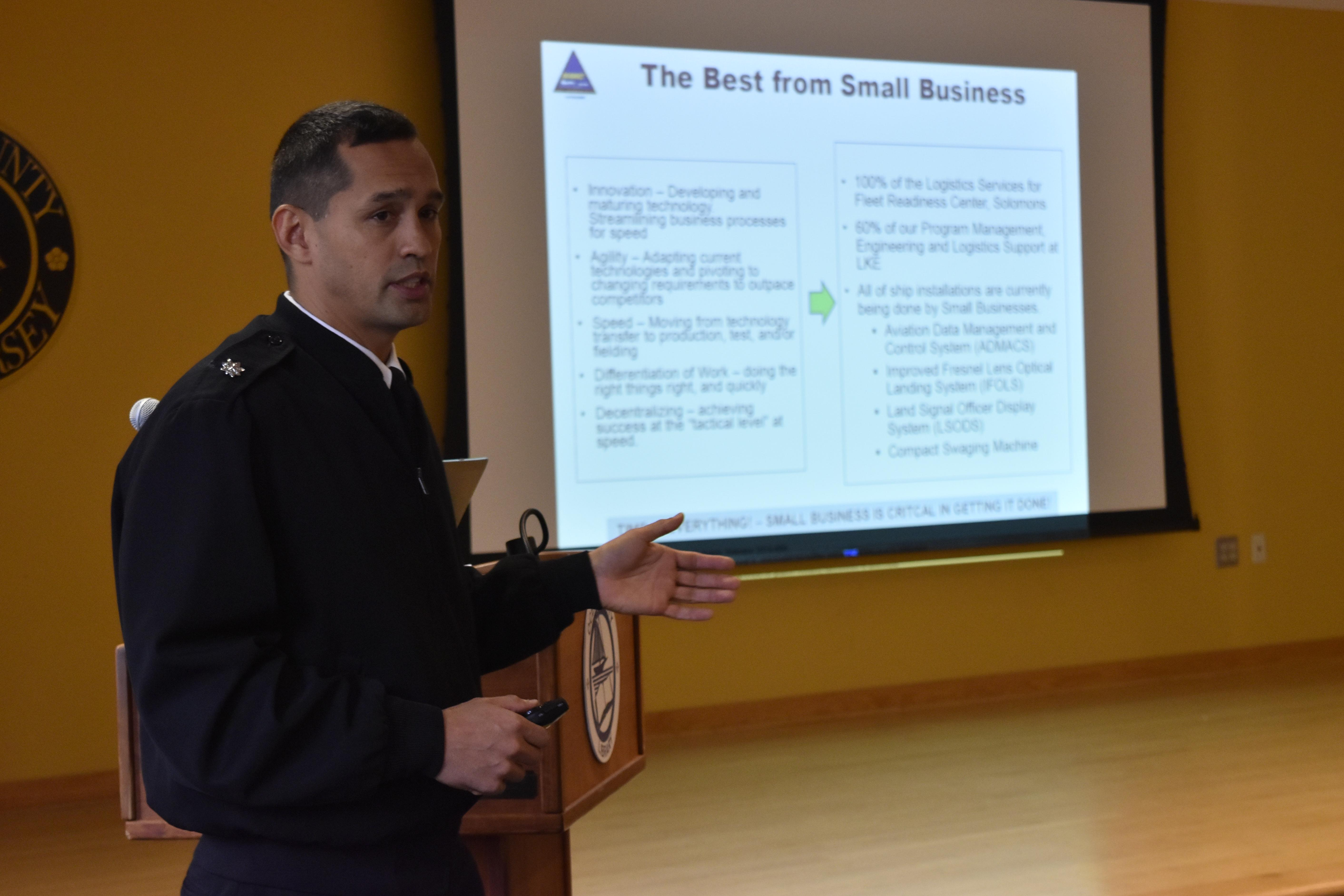"Officer-In-Charge Cmdr. Walter A. Reynolds briefs ""The Best from Small Business"" slide"