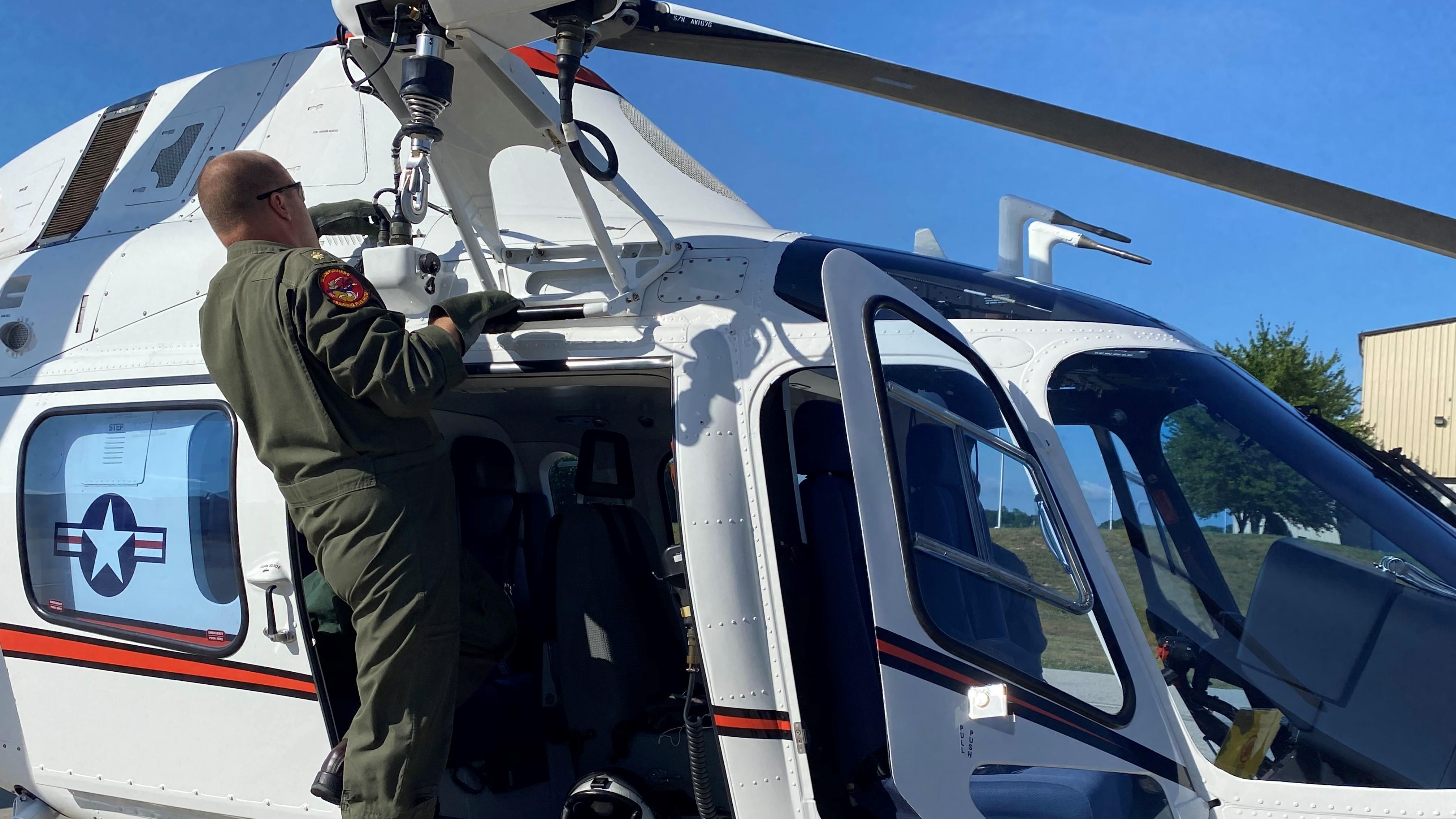 Instructor pilot conducts pre-flight check on TH-73A
