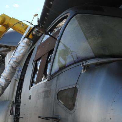 A mobile, autonomous robot deposits a cold spray coating on a V-22 aircraft
