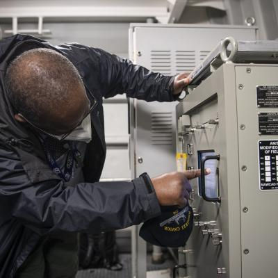 SPN-41B technician V/5 checks the screen on an AN/SPN-41B component/system aboard ITS Cavour