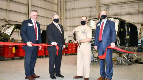 Navy captain and local dignitaries cut ribbon during opening ceremony