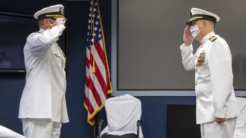 Capt. Ryan Bryla, left, relieves Capt. A.J. McFarland as commodore of Naval Test Wing Pacific during a change of command ceremony June 19 in Point Mugu, California. (U.S. Navy photo by Brian Wulfekotte)